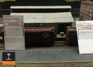 Car cards identify the destination of each piece of rolling stock on the layout.