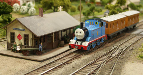 Thomas pulls up to the station to pick up his passengers